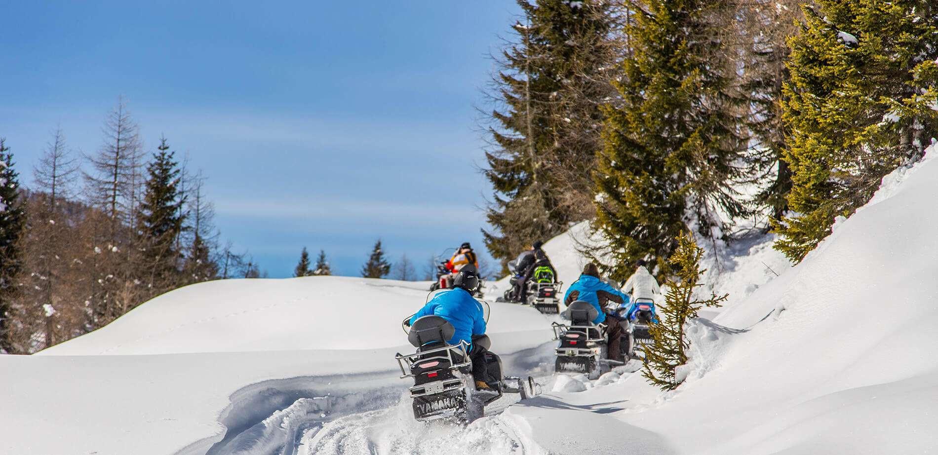 Escursione in motoslitta sul Passo Digola