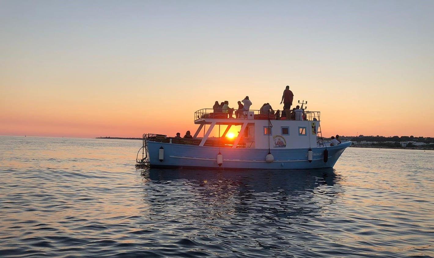Tour in barca al tramonto alle grotte di S. Maria di Leuca
